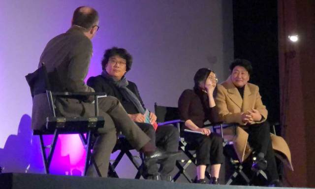 Bong Joon-ho and Song Kang-ho answering questions with the assistance of Sharon Choi