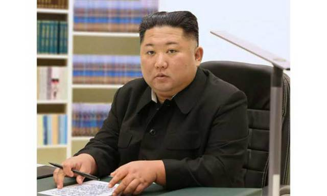 Kim Jong Un with his 2021 New Year letter
