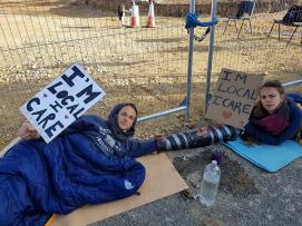 Local residents protest against coal mining, chaining themselves together to block mining operations