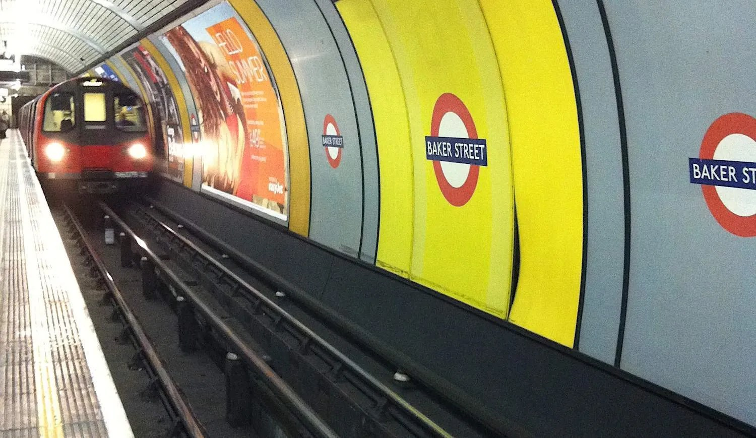 Tube entering London Underground Station