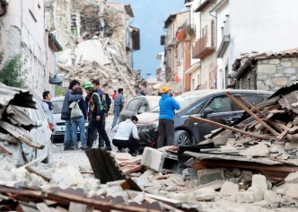 People stand along a road following a quake in Amatrice, central Italy, August 24, 2016. REUTERS/Remo Casilli