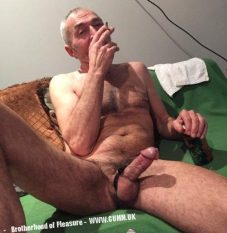 older man wanking and smoking