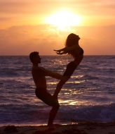 Dubai Tantra class. In June Mary on the beach in Tantric sunset Yoga demonstration
