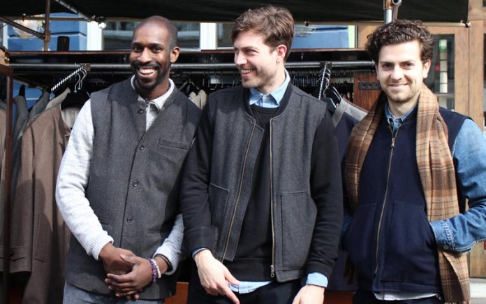 Three guys outside smiling