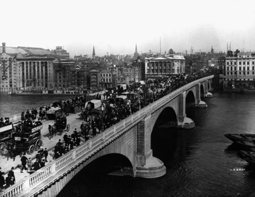 ca. 1904, London, England, UK --- Traffic on London Bridge. Photo shows: A view of London Bridge. The bridge is full of pedestrians, horse drawn omnibuses and horse drawn carriages. Various wharfs and warehouses are visible on the left of the shot across the river. --- Image by © Hulton-Deutsch Collection/CORBIS