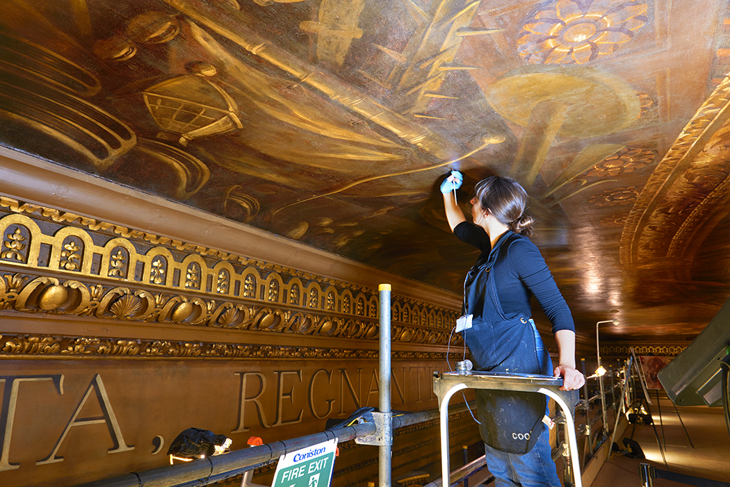 Virginia Nouwen restoring the Painted Hall Ceiling. Photographer coypright Peter Dazeley