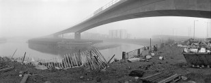 DLR viaduct over Bow Creek in fog, with Pura Foods in the background. Photograph by Peter Marshall 1992.
