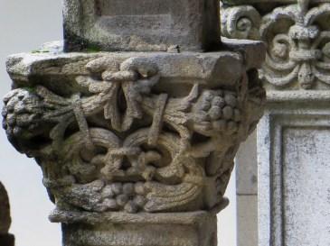 Carved column head in Patio of San Juan