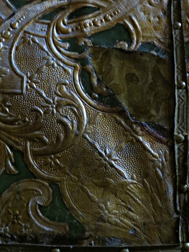 Tooled leatherwork on door