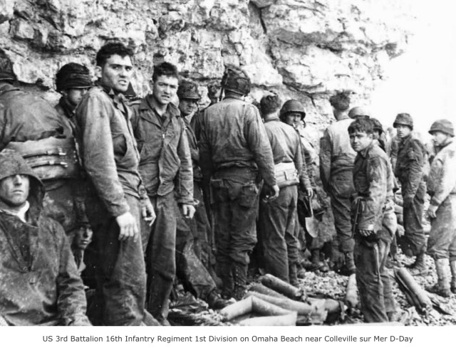 American soldiers near Omaha Beach (http://www.worldwarphotos.info/gallery/france/normandy-1944/us-3rd-battalion-16th-infantry-regiment-1st-division-on-omaha-beach-near-colleville-sur-mer-d-day/)