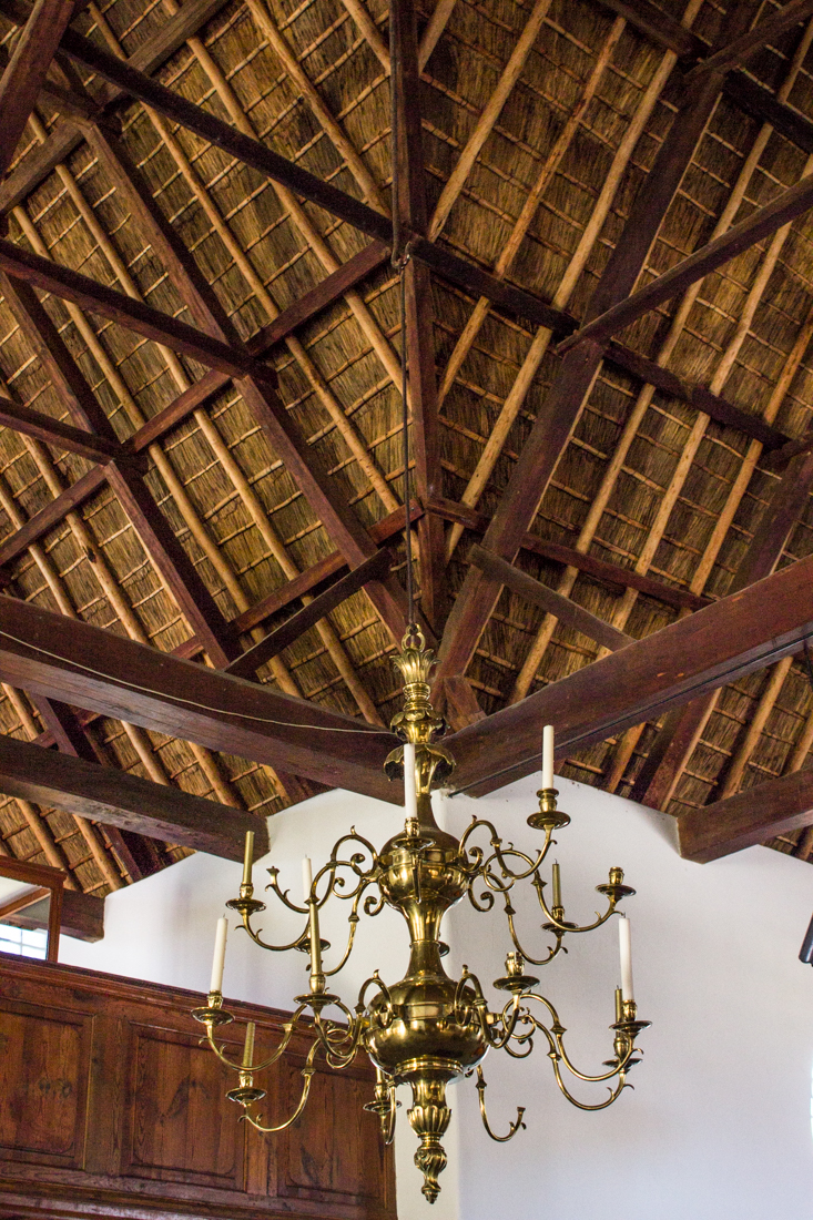 The roof, upper gallery, & brass chandelier in The Old Church Museum in Tulbagh
