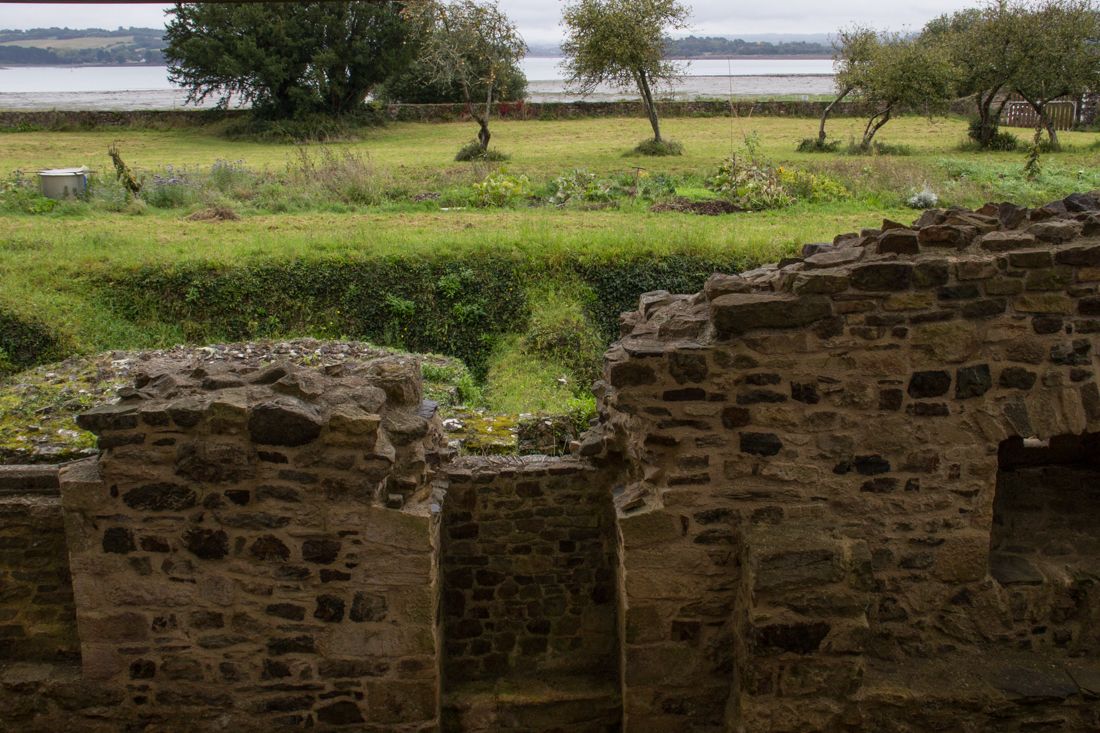 The remains of 9C Abbey buildings overlooking the river