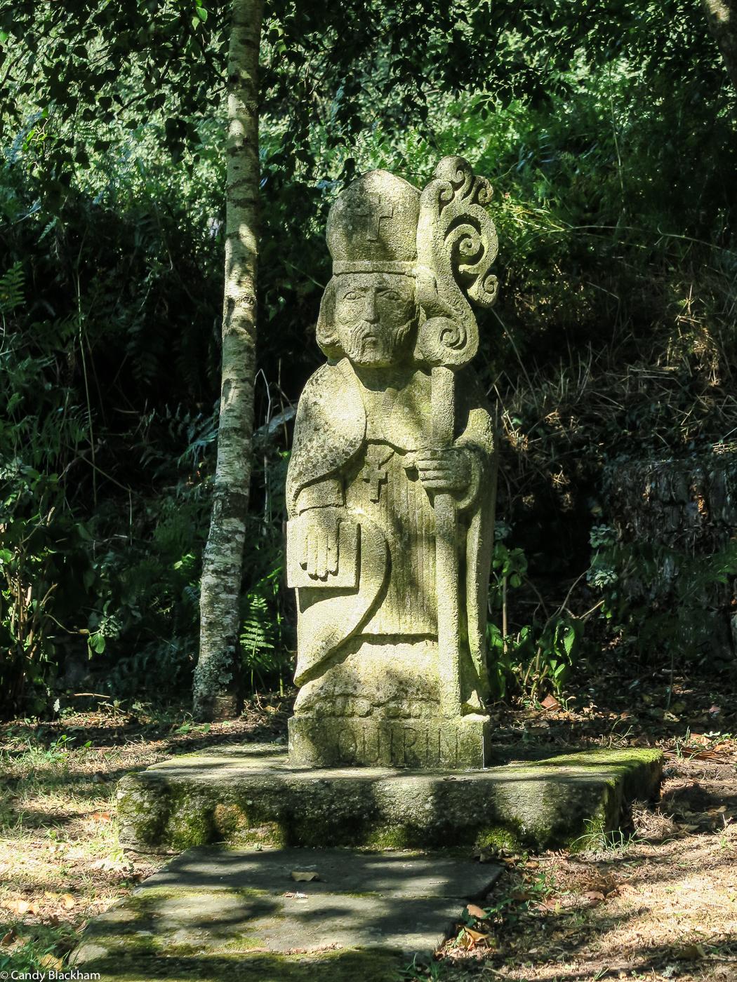 Saint Quirin next to his fountain