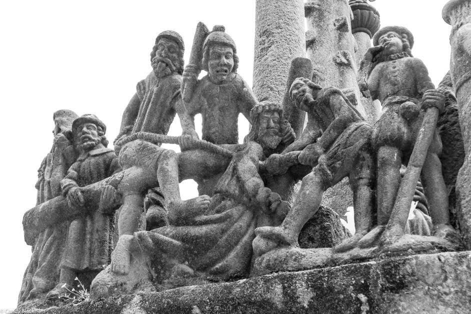 Grotesque figures around Christ carrying the cross at Saint-Thégonnec