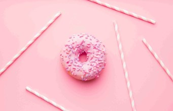 Pink donut and pink straws.