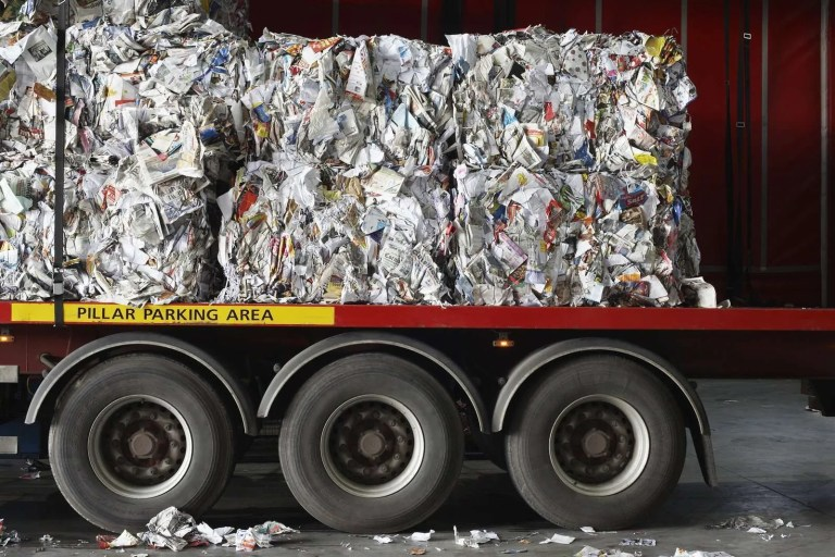 10009486_stacks-of-recycled-papers-on-lorry-in-recycling-plant