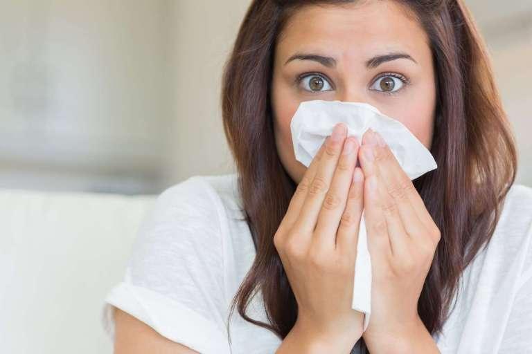 7039750_brunette-sneezing