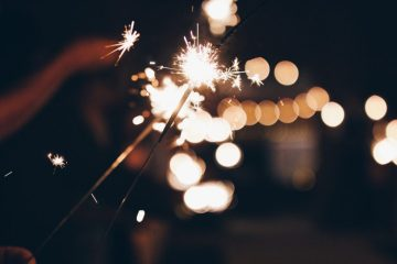 Bokeh photo of people holding sparklers