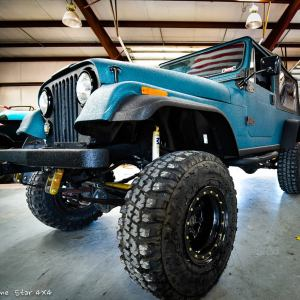 Teal Sprayed Jeep Scrambler