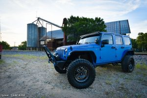 Sprayed Blue Jeep Rubicon Drivers Side View of Tires