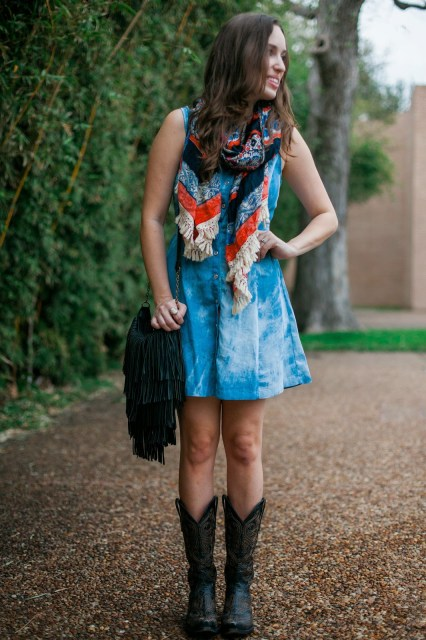 old gringo boots, black old gringo boots, houston rodeo style, houston texas rodeo style, rodeo outfit inspiration, anthropologie fringe scarf, anthropologie blue and red scarf, chambray dress and cowboy boots, fringe purse, cavender's purse, cavender's old gringo boots, the lone star looking glass, houston fashion blog, houston fashion blogger, houston style blog