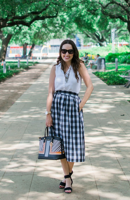 anthropologie plaid midi skirt, plaid midi skirt, buffalo plaid midi skirt, anthropologie buffalo plaid, anthropologie gingham midi skirt, anthropologie black and white gingham midi skirt, ugg char mar heels, henri bendel west 57th sport satchel, jord wood watch