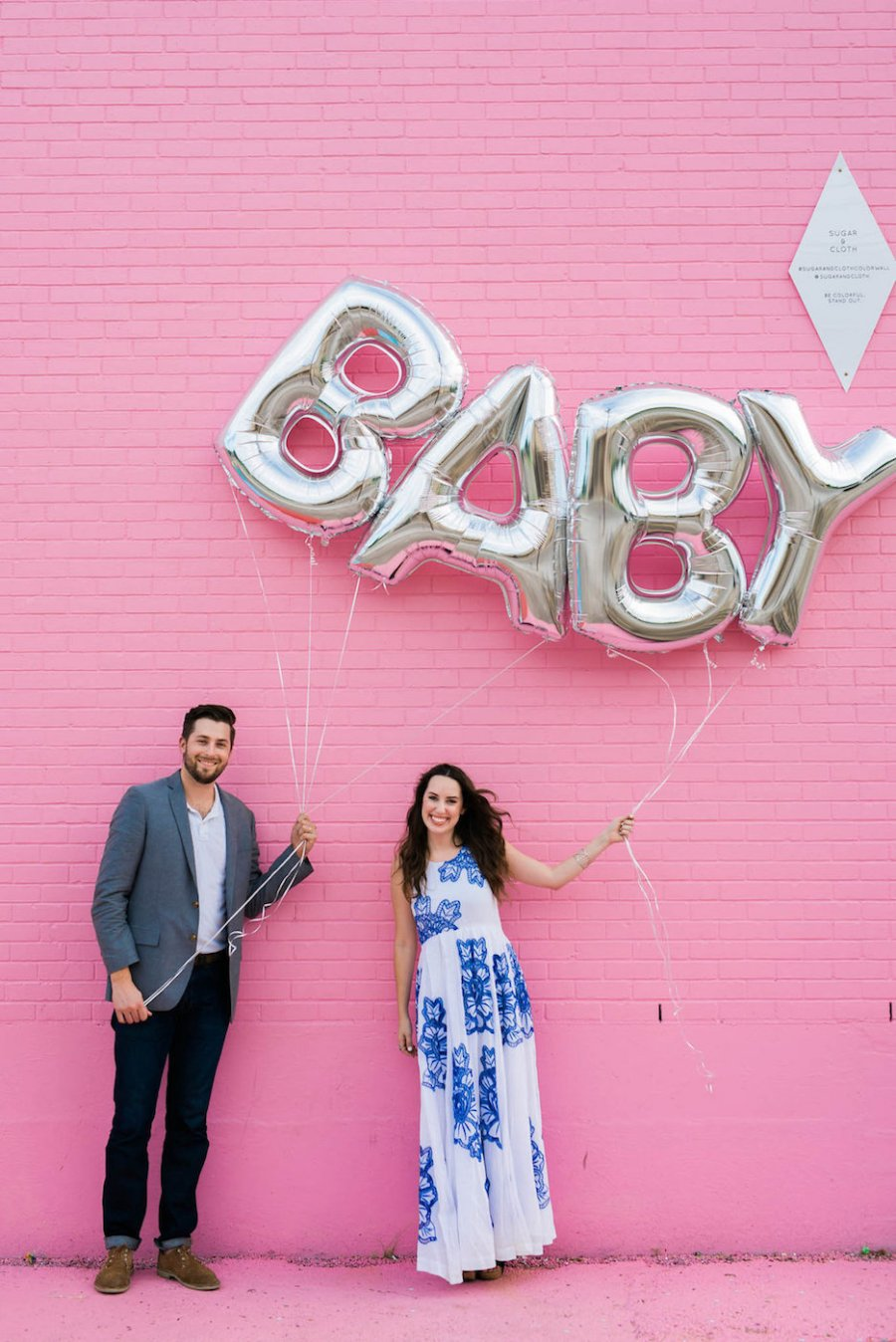 pink baby gender reveal ideas, baby balloon reveal, sugar and cloth color wall, baby balloons, silver baby balloons, baby girl reveal idea
