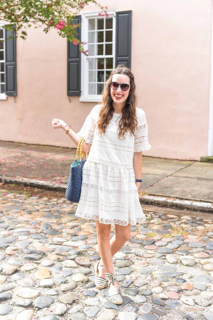 Styling the Clarimond White Lace Dress from Anthropologie and KAS New York with espadrilles and a straw tote in Charleston.
