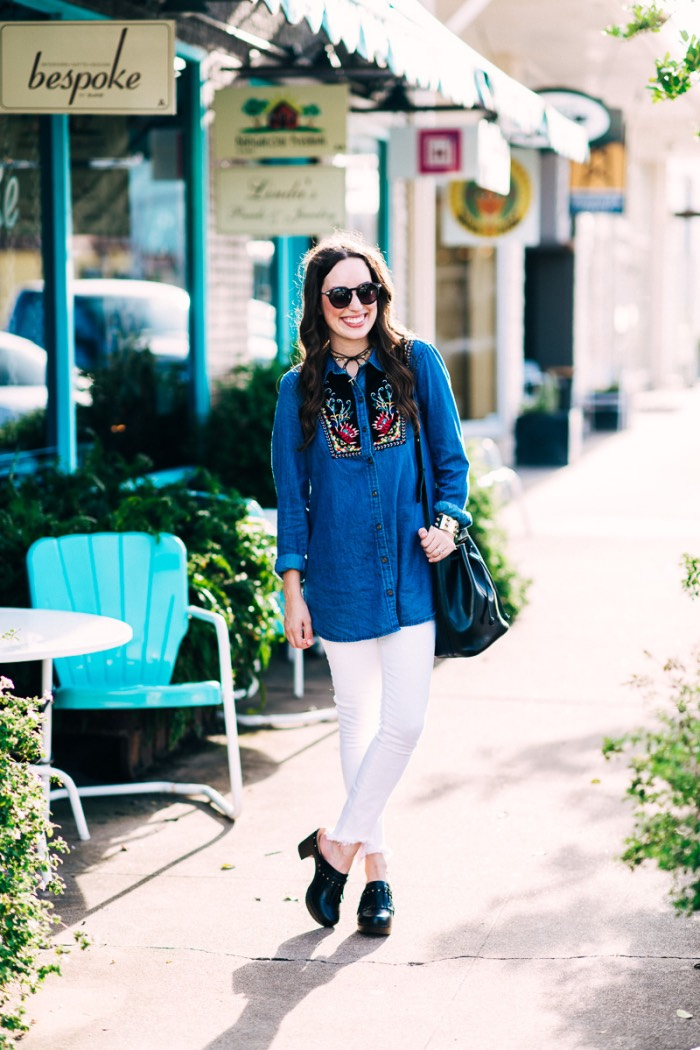 Houston fashion blogger Alice Kerley styles Anthropologie's Murelet Embroidered Chambray Tunic with Dansko Deni Clogs and white true religion jeans.