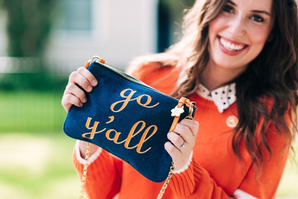 The Draper James Go Y'all Envelope Clutch in Tennessee Orange