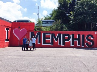 Taking a photo at the I Love Memphis Sign wall art in Cooper Young.