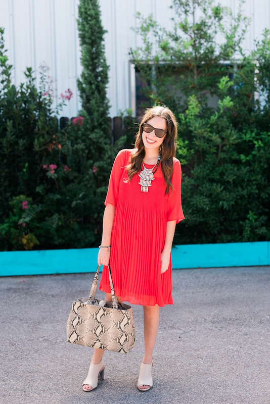 Styling a red anthropologie shift dress with snake print shoes and a matching tote.