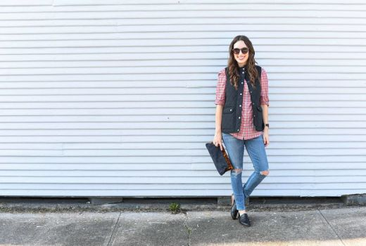 Alice Kerley of Lone Star Looking Glass styles a J.McLaughlin Plaid Lois Blouse, Black Vest and Denim Clutch for fall.