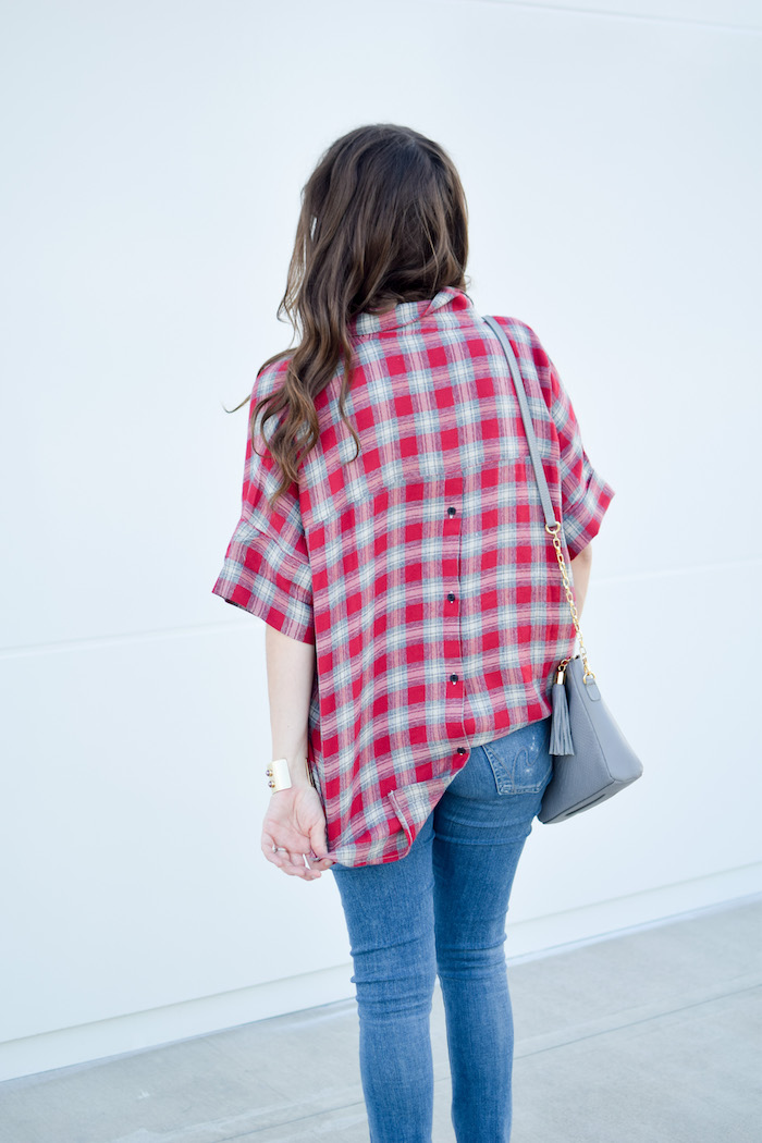 Houston Fashion Blogger Alice Kerley styles a simple fall transitional look with a Madewell red red plaid Madewell shirt, distressed denim, and a gigi new york handbag.