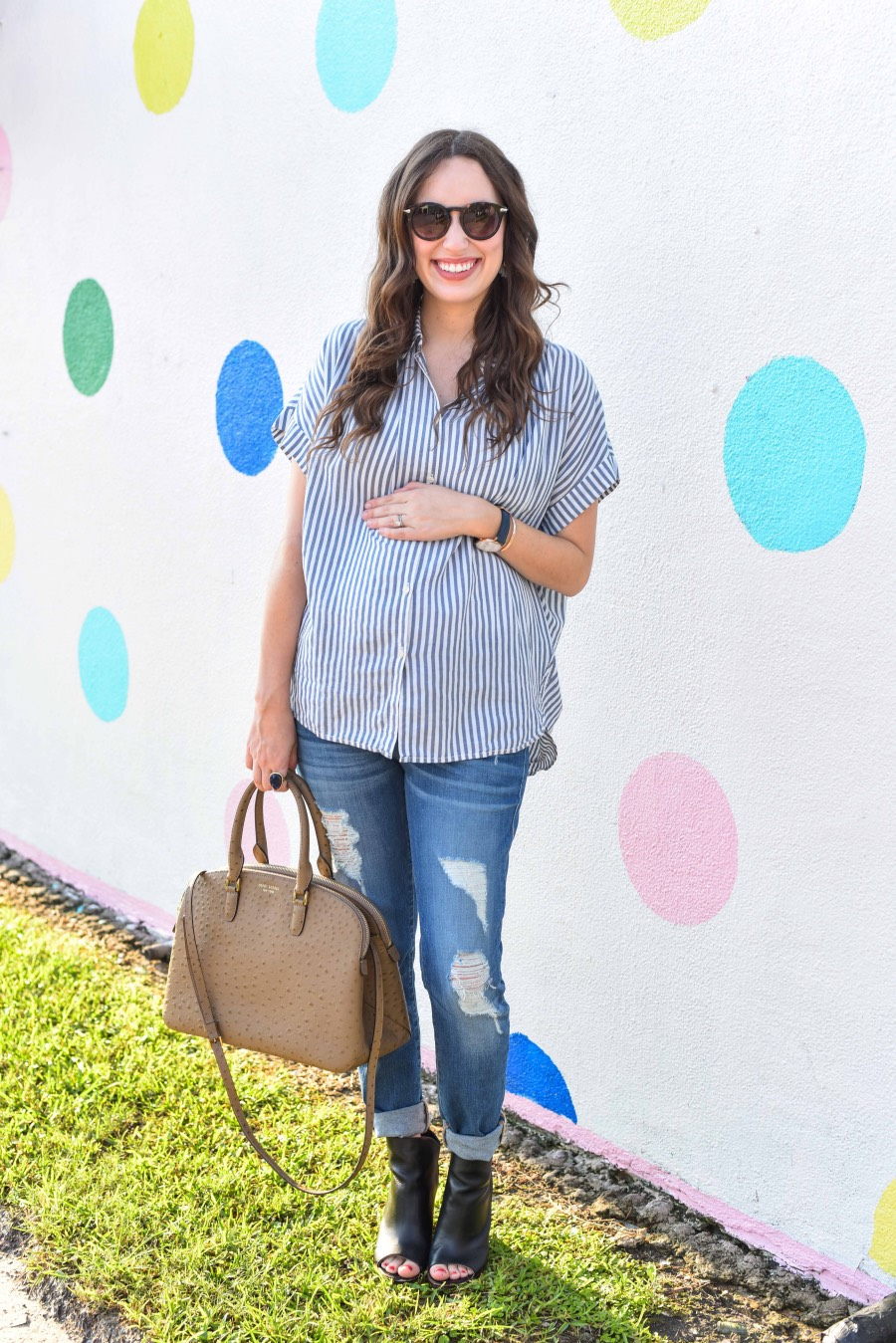 Alice of Lone Star Looking Glass shares tips on how to wear your regular jeans when you're pregnant in her True Religion jeans and a Madewell striped top.