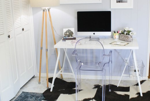 Living room office space inspiration with a DIY cowhide rug and a travel photo gallery wall from FLOR and Framebridge.