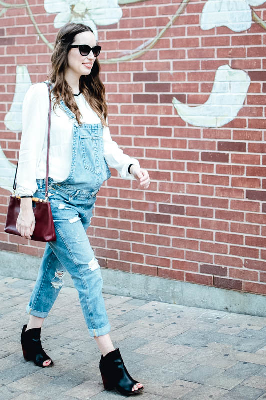 Texas Fashion Blogger styles True Religion overalls with a Seraphine Maternity top for fall.