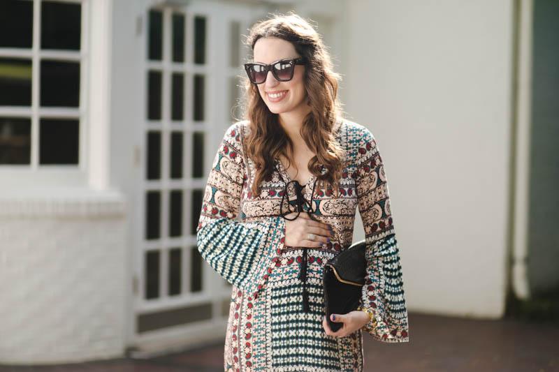 Texas fashion blogger styles a Planet Blue Printed Maxi Dress with black Sole Society Heels & a Henri Bendel Clutch.