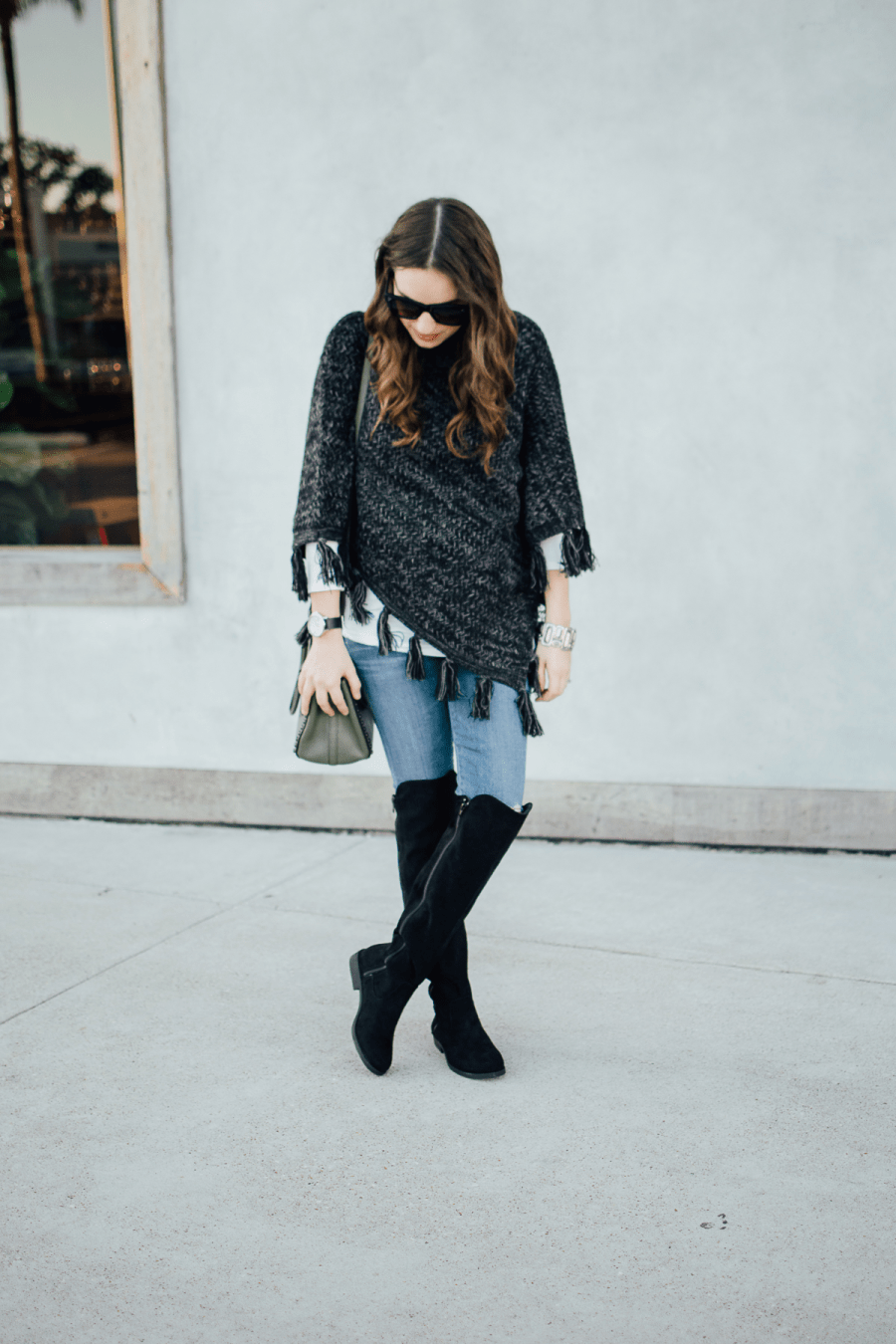 Texas blogger shares fall outfit inspiration with a fringe poncho and black over the knee boots from Macy's and Style&Co.