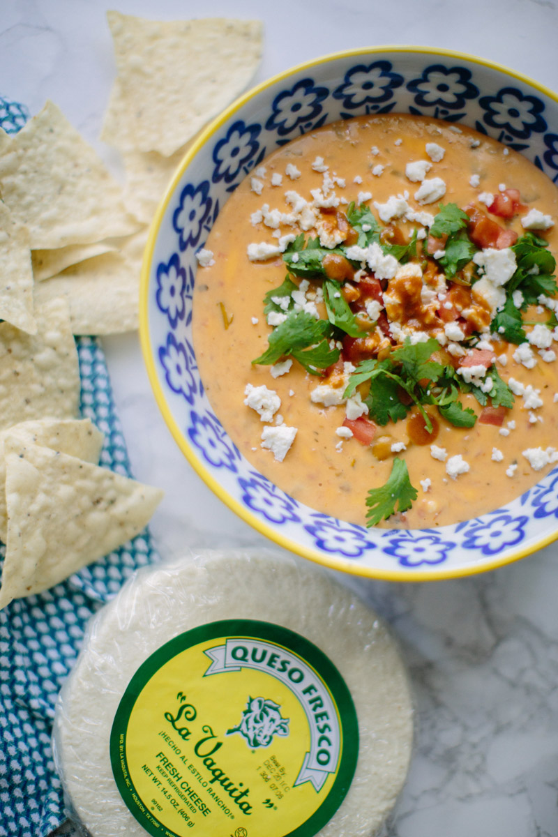 Texas style queso recipe: cheese dip with green chilis, hot sauce and la vaquita cheese.