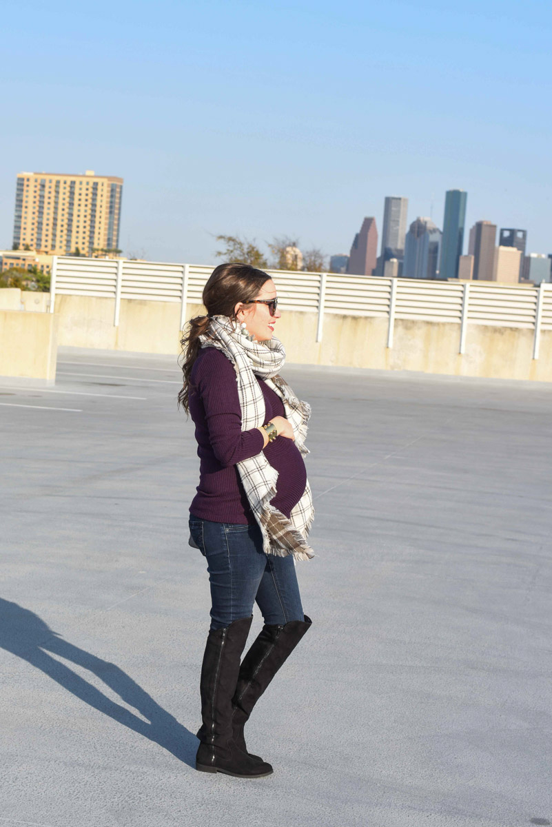 Houston fashion blogger shares a winter maternity outfit with a stowaway maternity purple sweater and an Anthropologie plaid scarf.