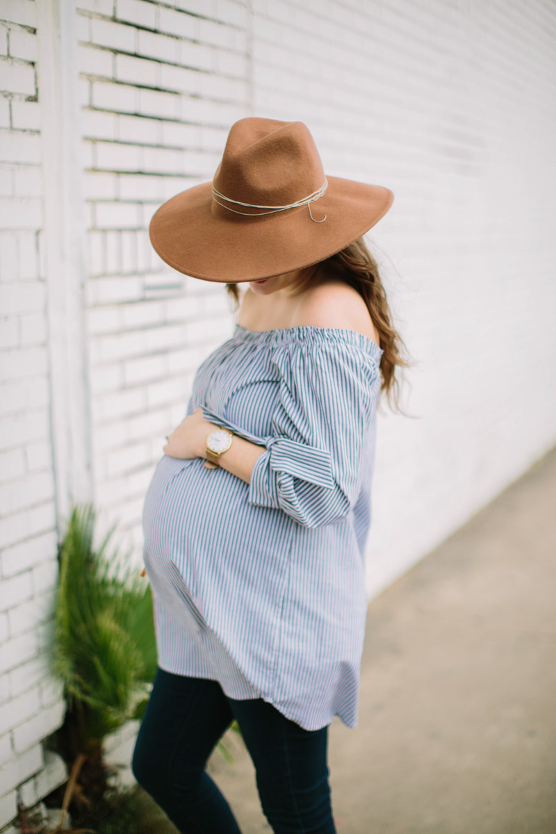 Houston fashion blogger styles an Audrey and Olive striped off the shoulder maternity shirt with a shore projects watch and free people rancher hat.