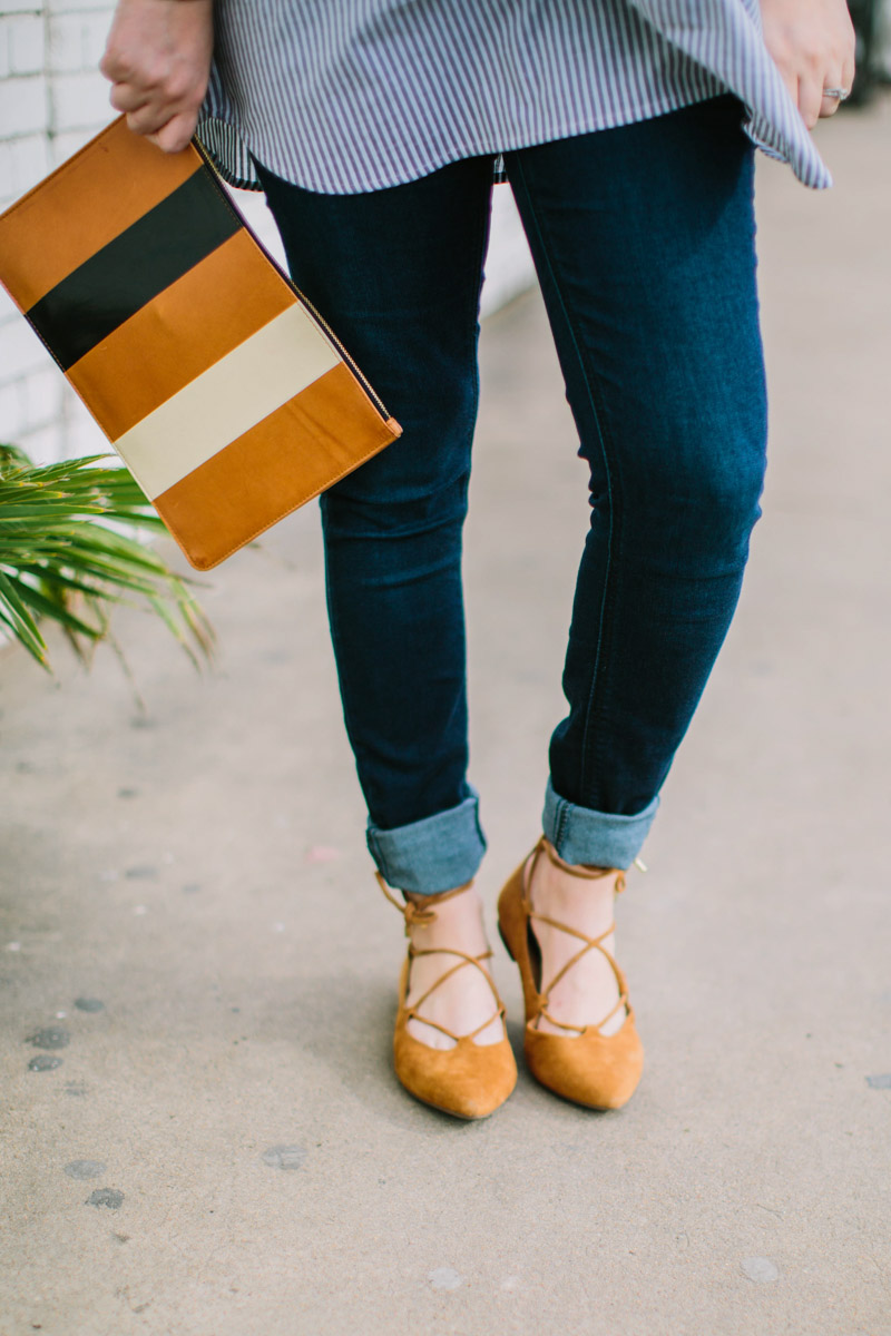 Houston fashion blogger styles a pea in the pod maternity jeans with vionic lace up flats and a clare vivier striped clutch.