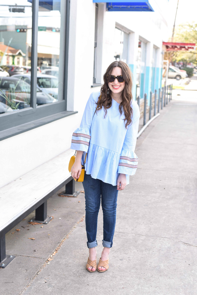Houston fashion blogger styles a striped Chicwish Top with a yellow Coach Dinky crossbody.