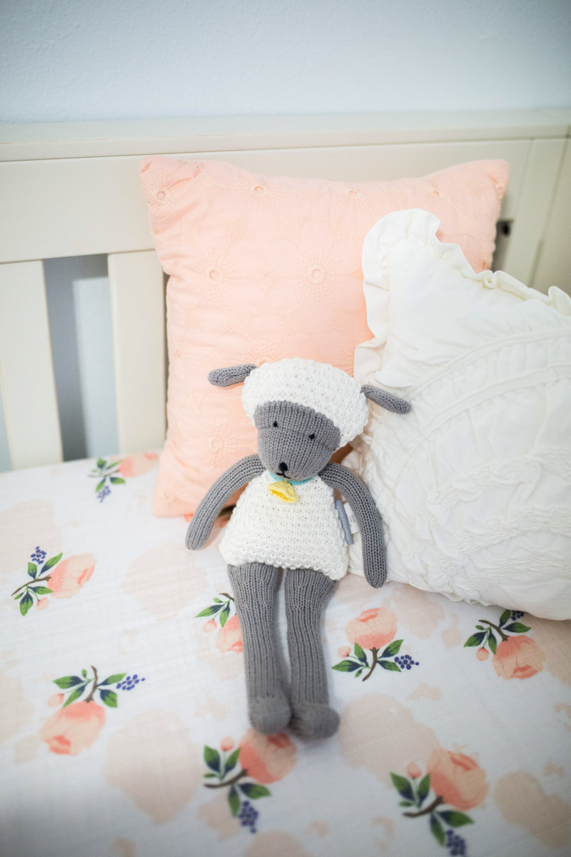 Ecelectic baby girl peach and blue nursery with Little Unicorn bedding.