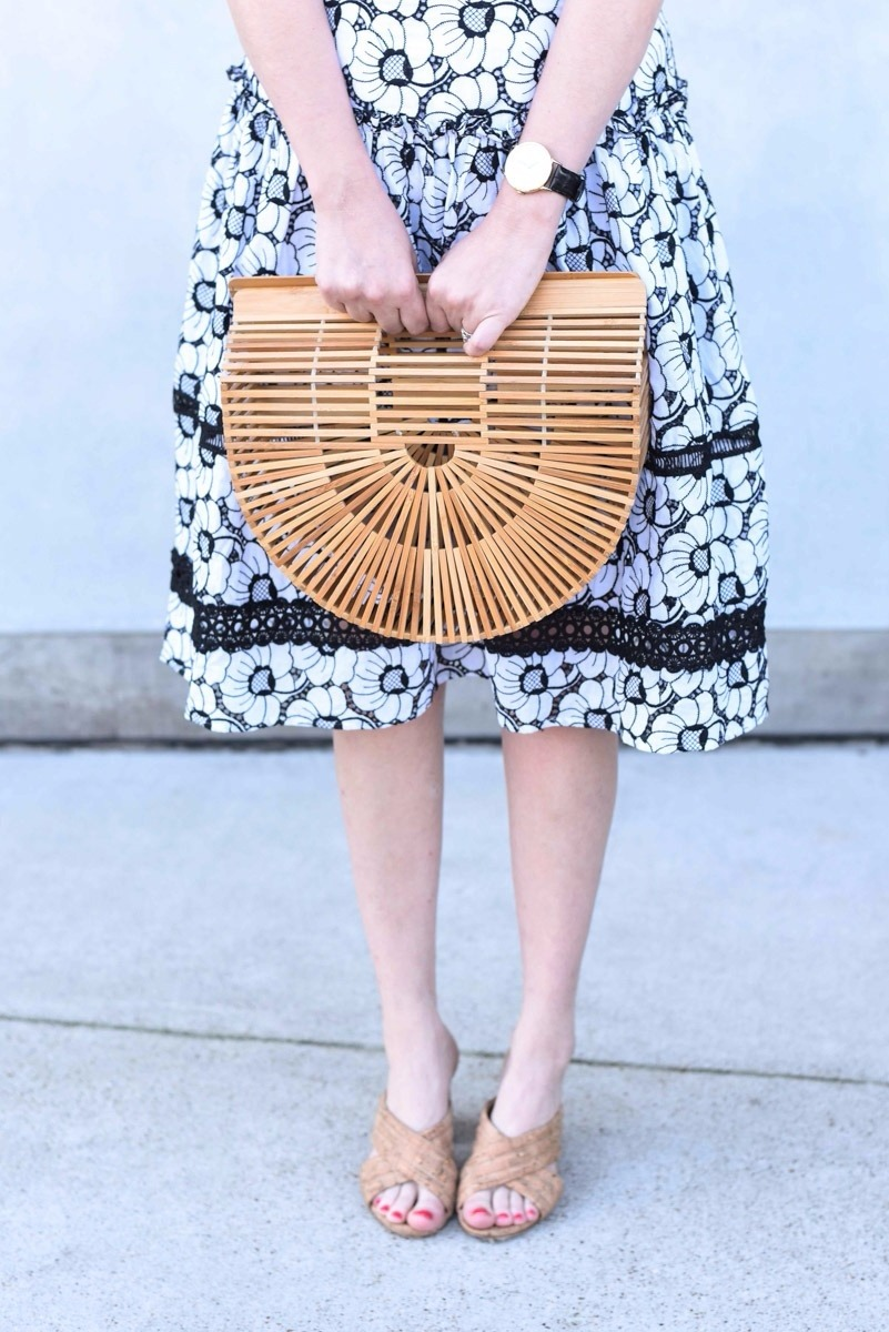 Houston blogger shares spring outfit inspiration in a black and white off the shoulder dress with a Cult Gaia bamboo bag.