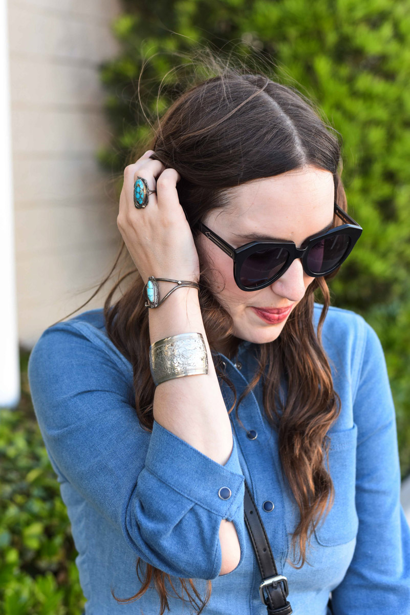 Rodeo boho style: Houston fashion blogger styles turquoise jewelry and denim shirtdress for a Southwestern look.
