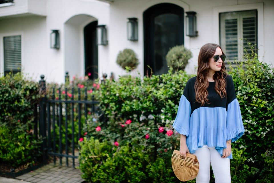 Houston blogger styles an outfit for spring: white true religion jeans, sole society wedges, a blue and black colorblocked chicwish top with a cult gaia handbag.
