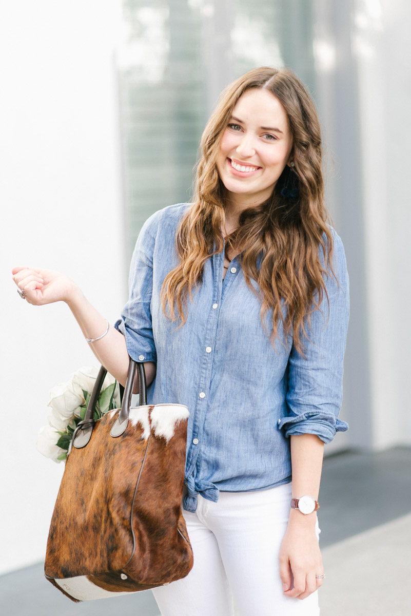 Houston fashion blogger Alice Kerley styles a chambray top with a cowhide tote bag.