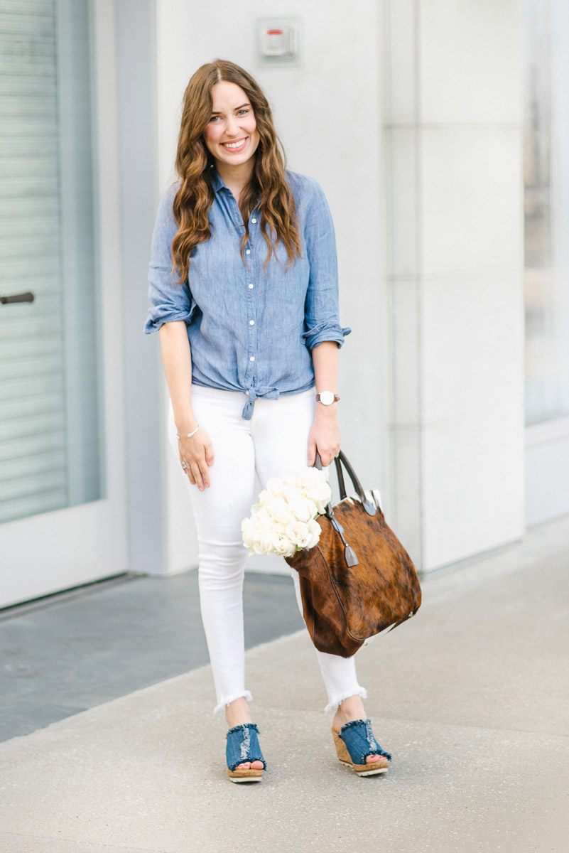 How to wear denim on denim with white jeans, a chambray top and denim Minnetonka wedges.
